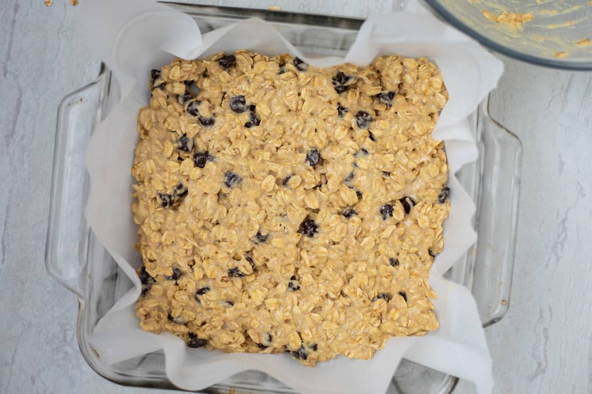 Oatmeal Cookie Bar Mixture in glass pan.