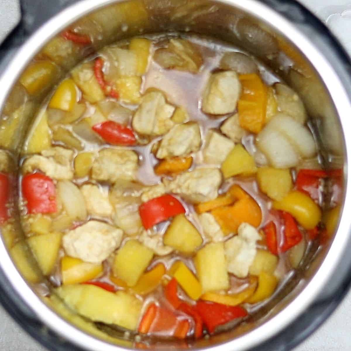 Cooked sweet and sour chicken inside inner pot.