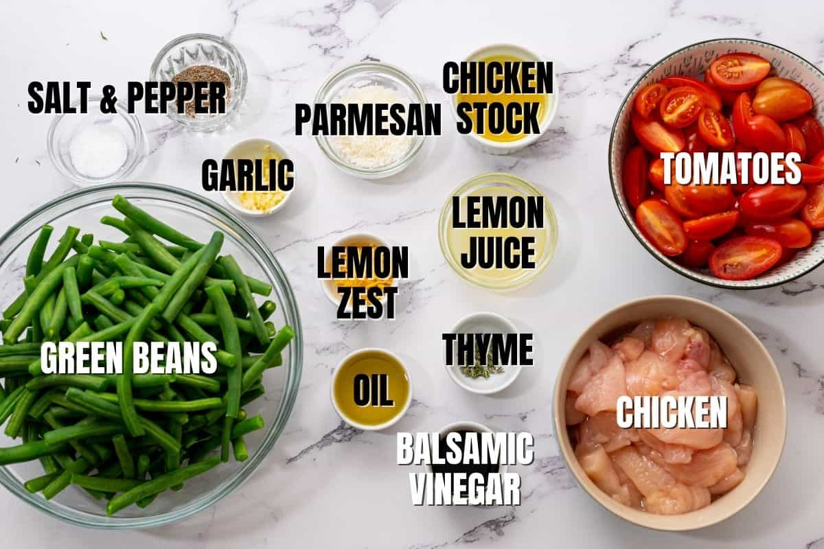 Ingredients labeled on white counter for chicken green bean skillet.