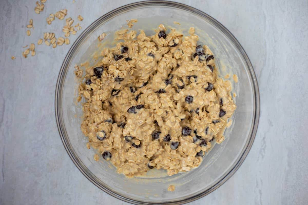 Mixing bowl with oatmeal cookie bar mixture.