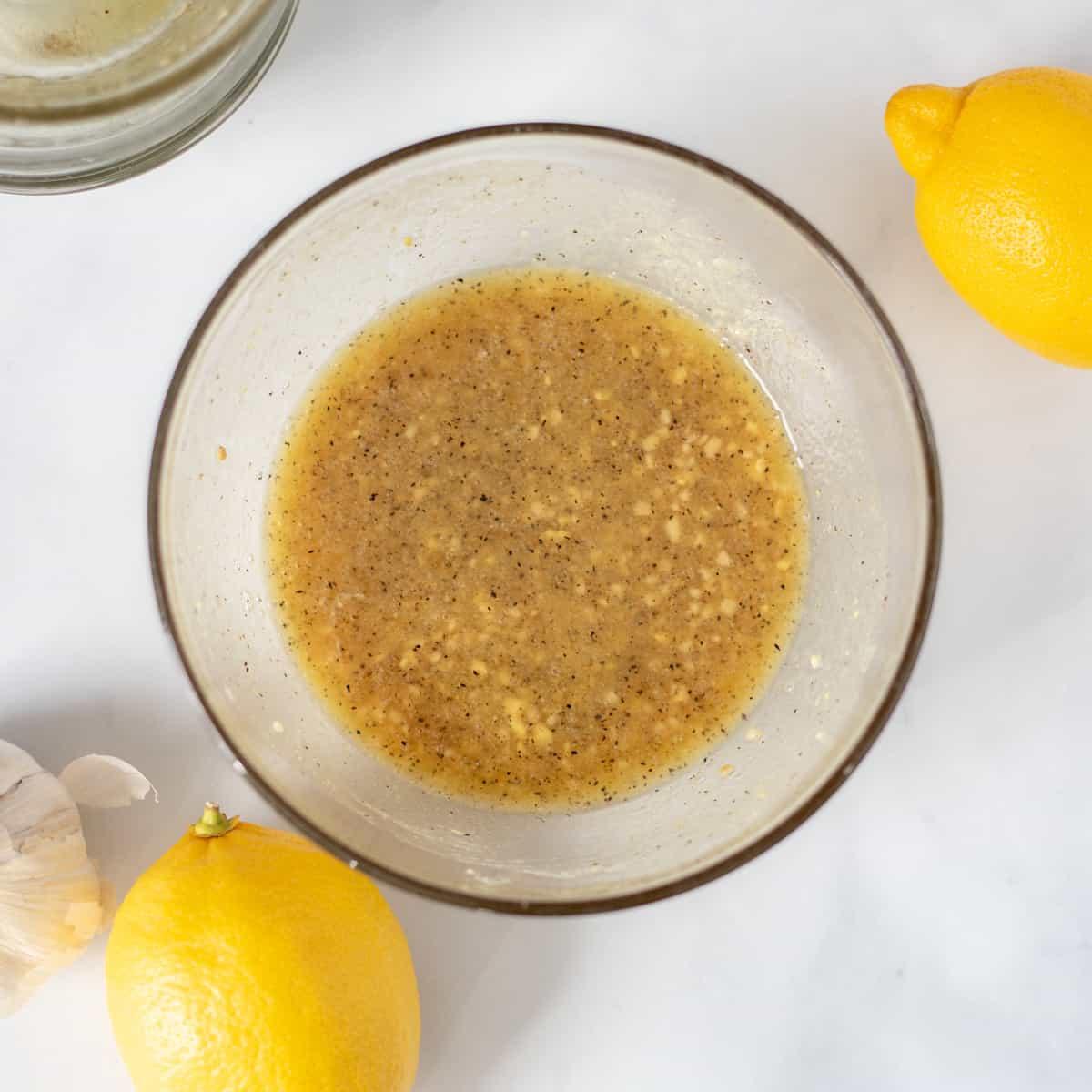 Honey Garlic Lemon Marinade mixed together in small mixing bowl.
