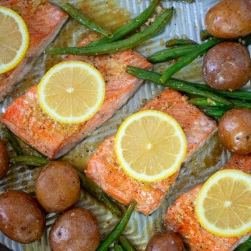 Sheet pan with salmon, potatoes, green beans.