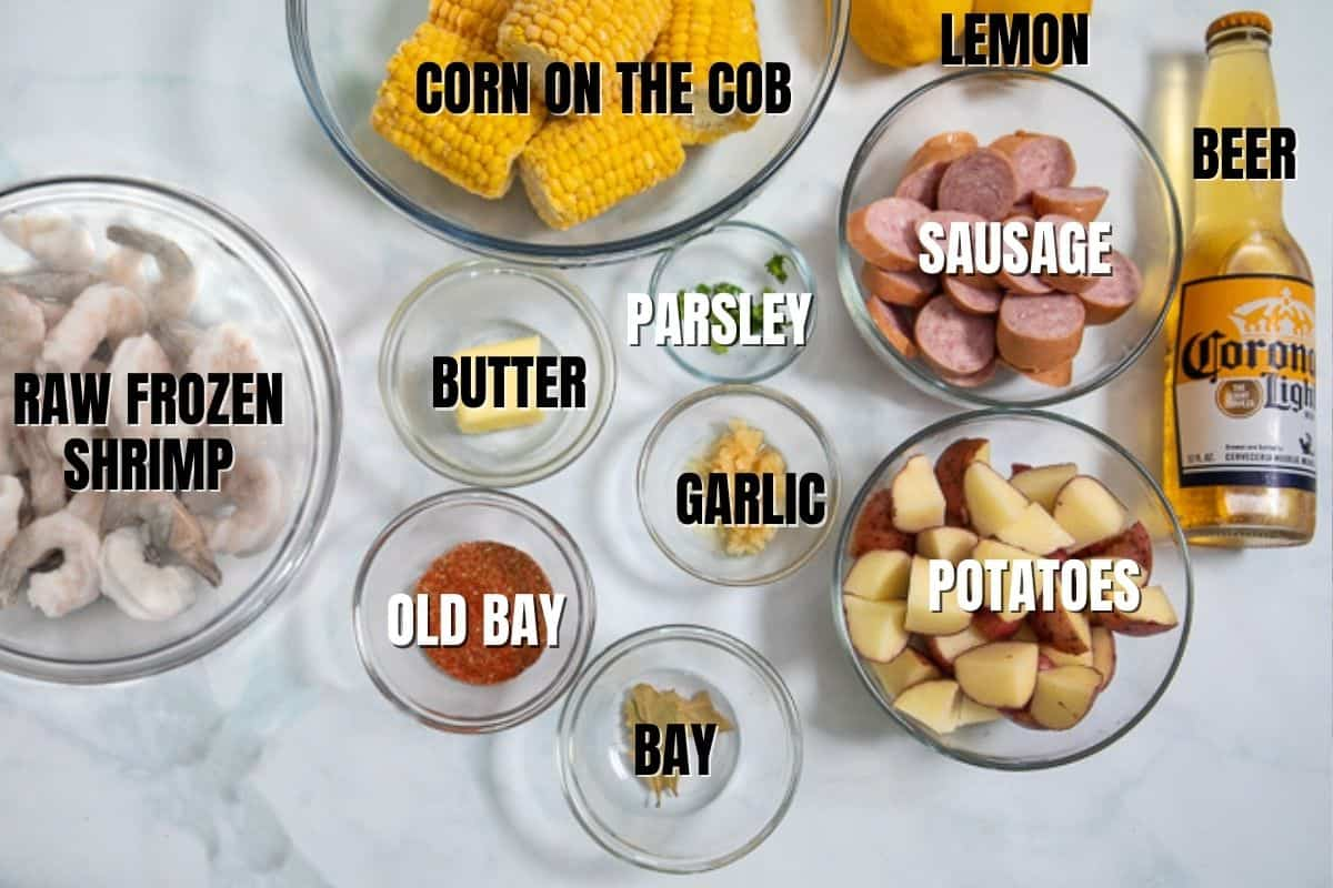 Ingredient for Instant Pot Shrimp Boil labeled on white counter.