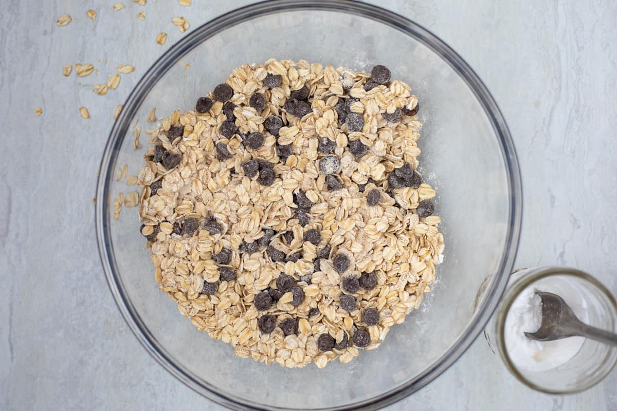 Mixing bowl with oats, flour, and chocolate chips.