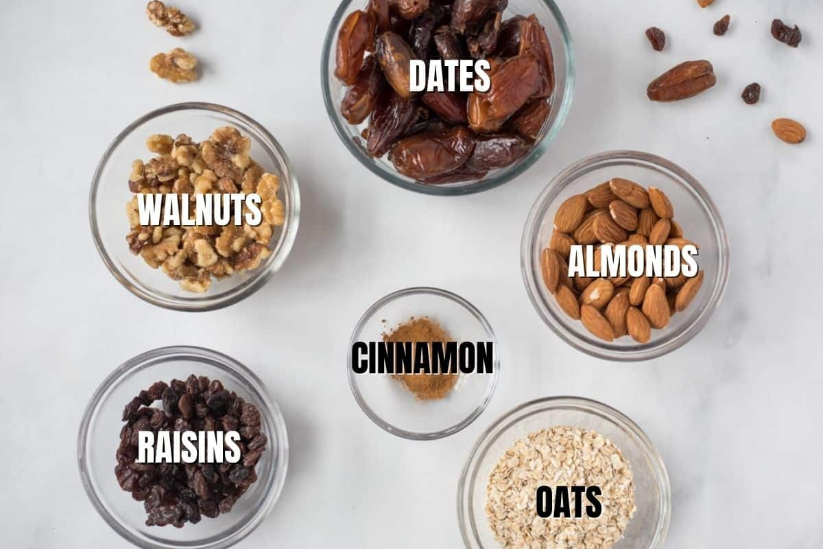 Labeled Ingredients for Oatmeal Balls on white counter.