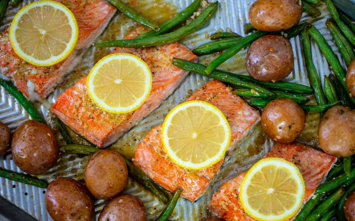 Salmon fillets on sheet pan with green beans and potatoes.