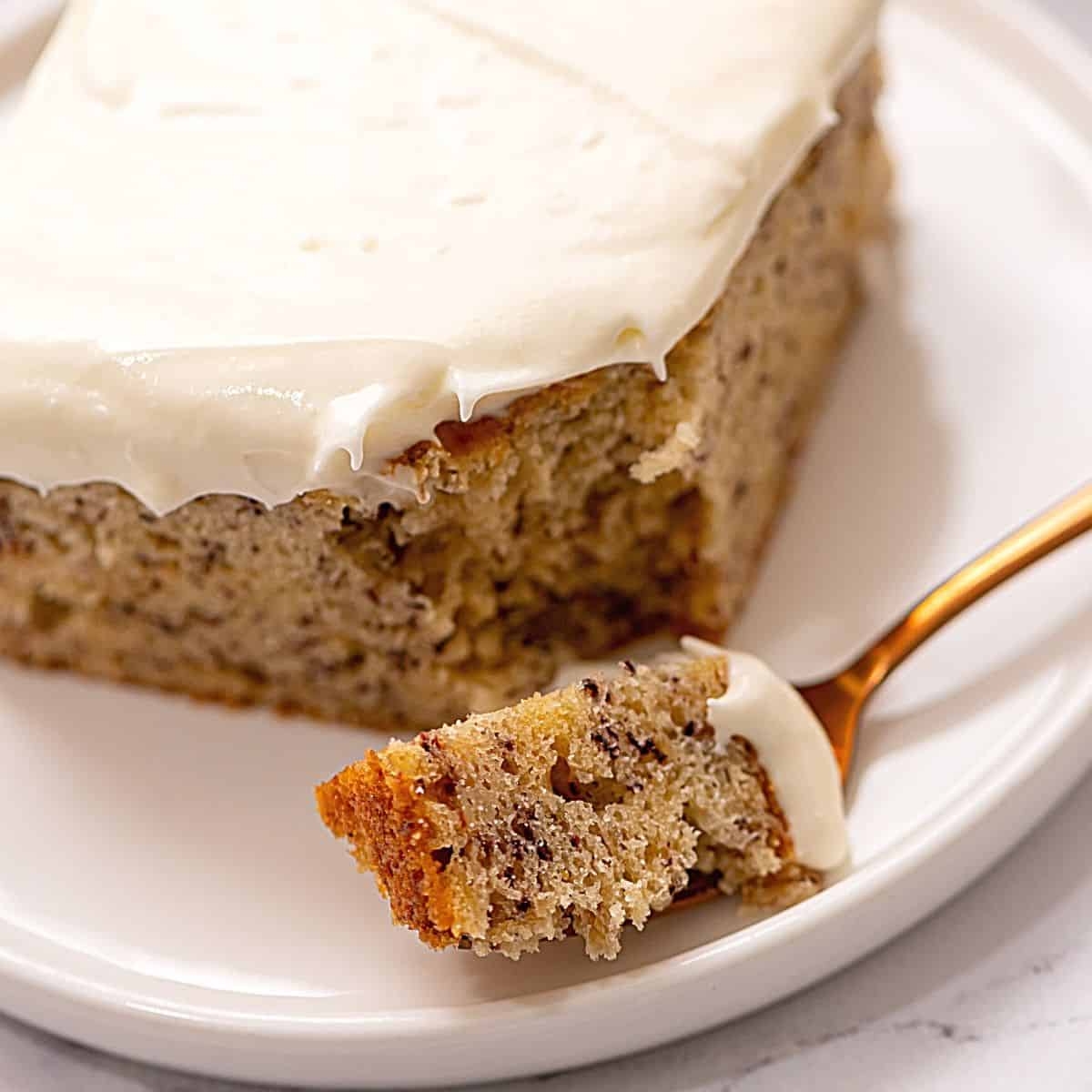 Fork with slice of banana cake on it.