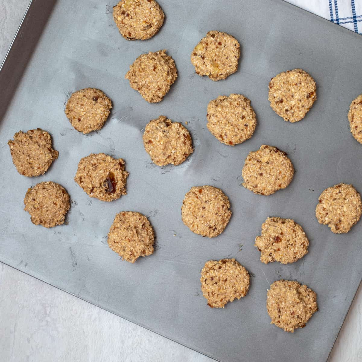 Banana Oat Cookies on baking sheet ready for oven.
