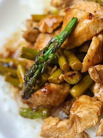 Close up of Asparagus Stir Fry served over rice.