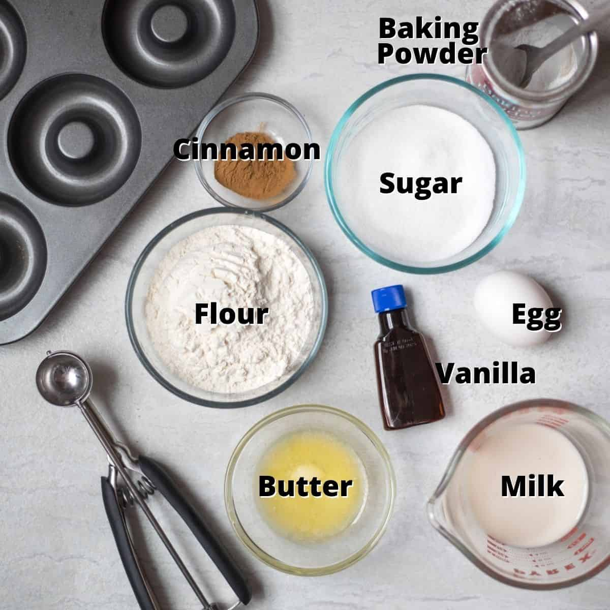 Ingredients for Baked Sugar Cinnamon Donuts on counter labeled.