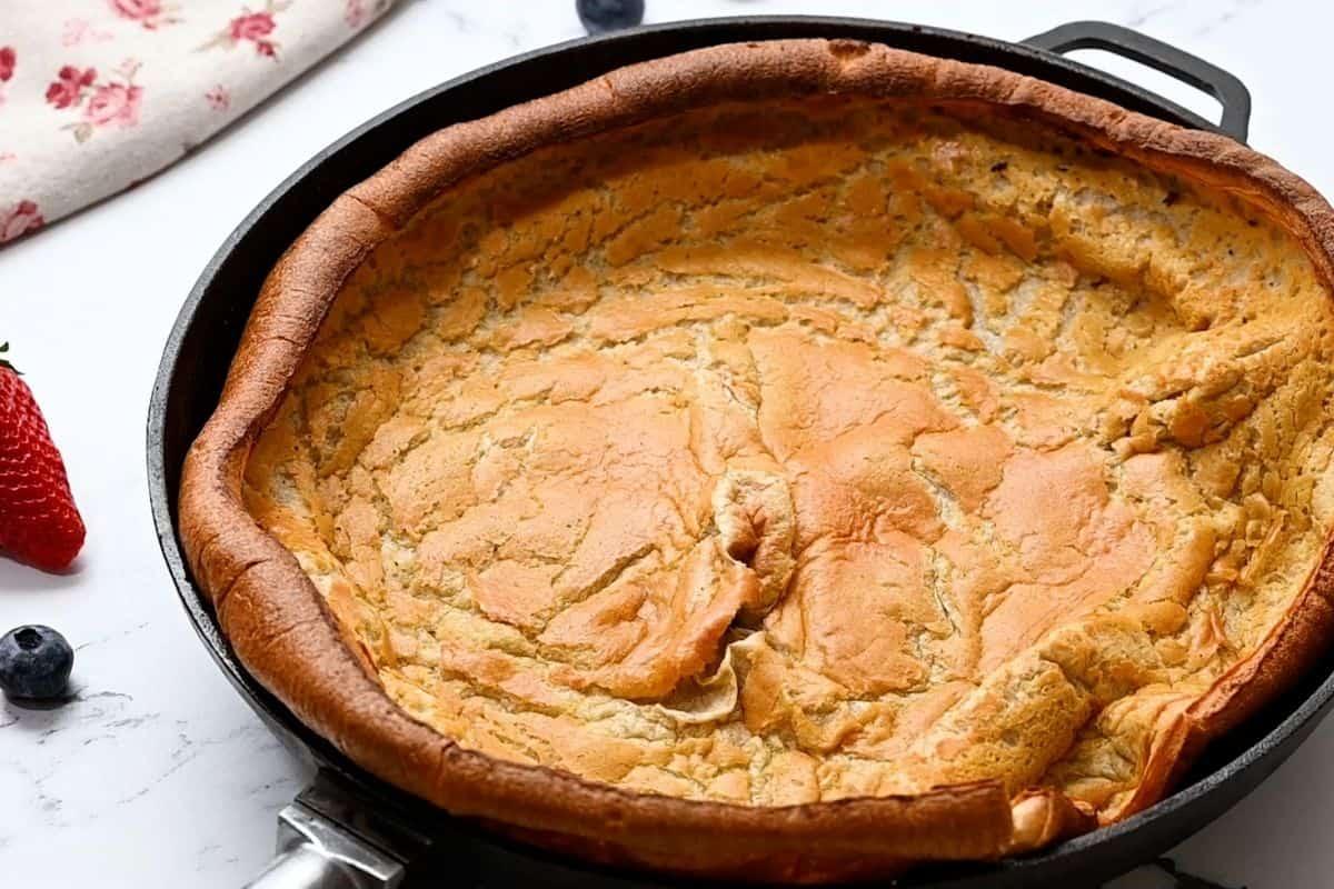 Baked German Pancake in cast iron skillet.