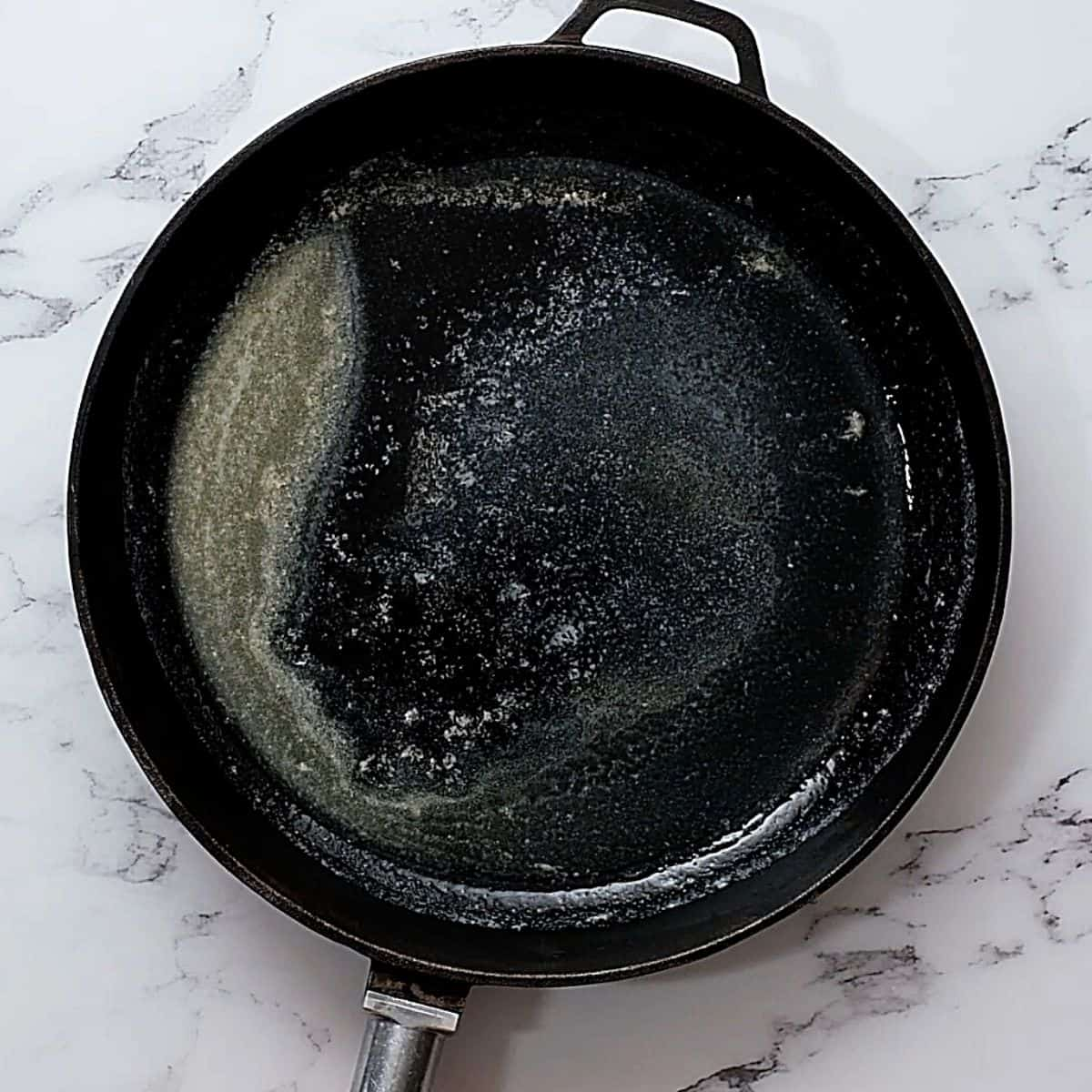 Skillet with melted butter.