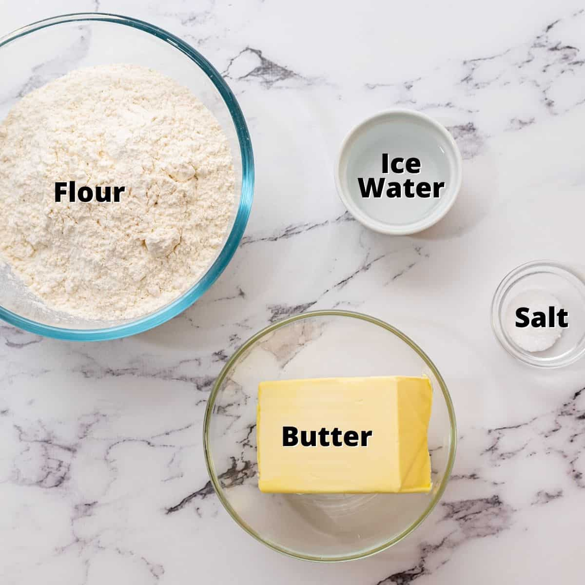 Ingredients labeled on white counter.