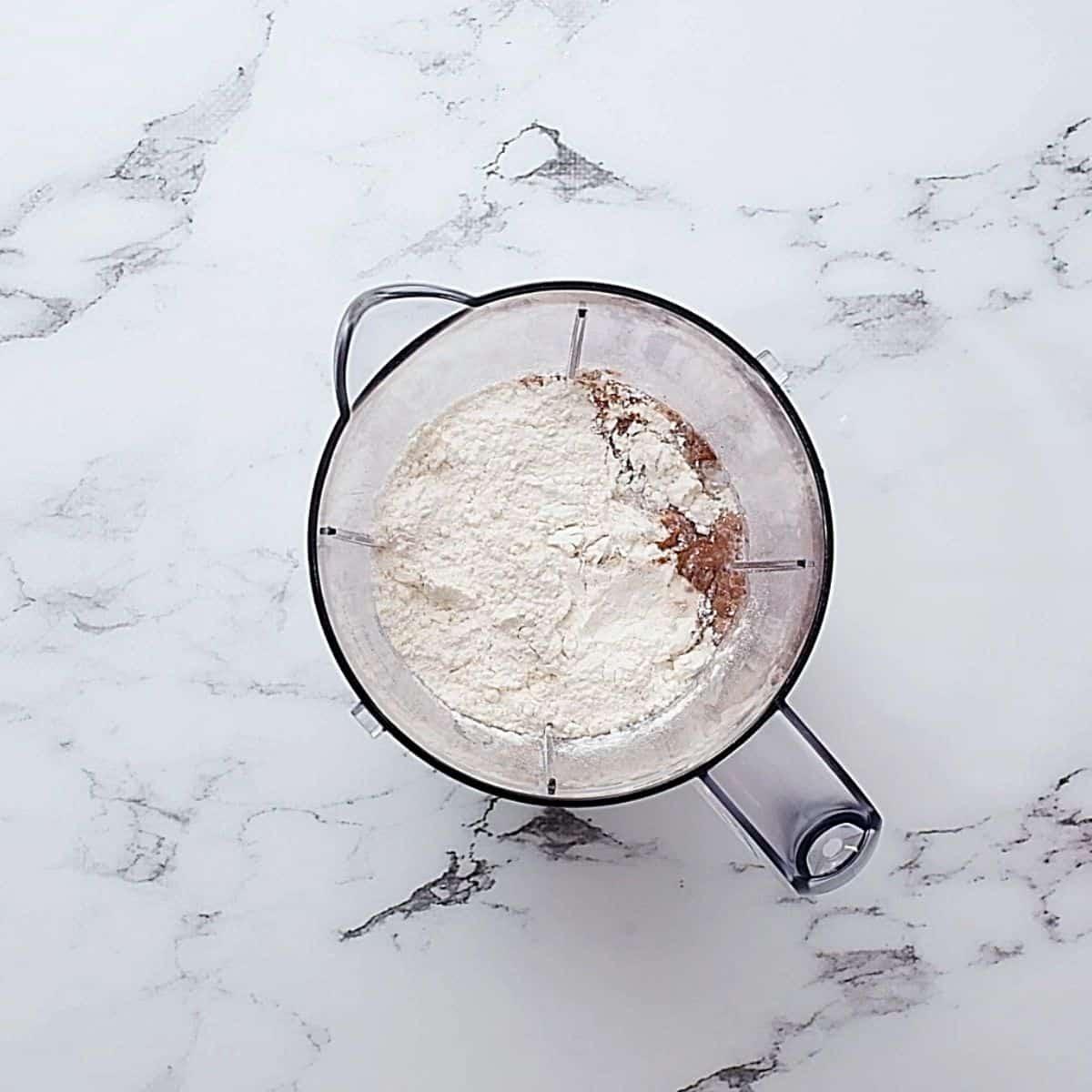 Blender with flour, eggs, milk, baking powder in it.
