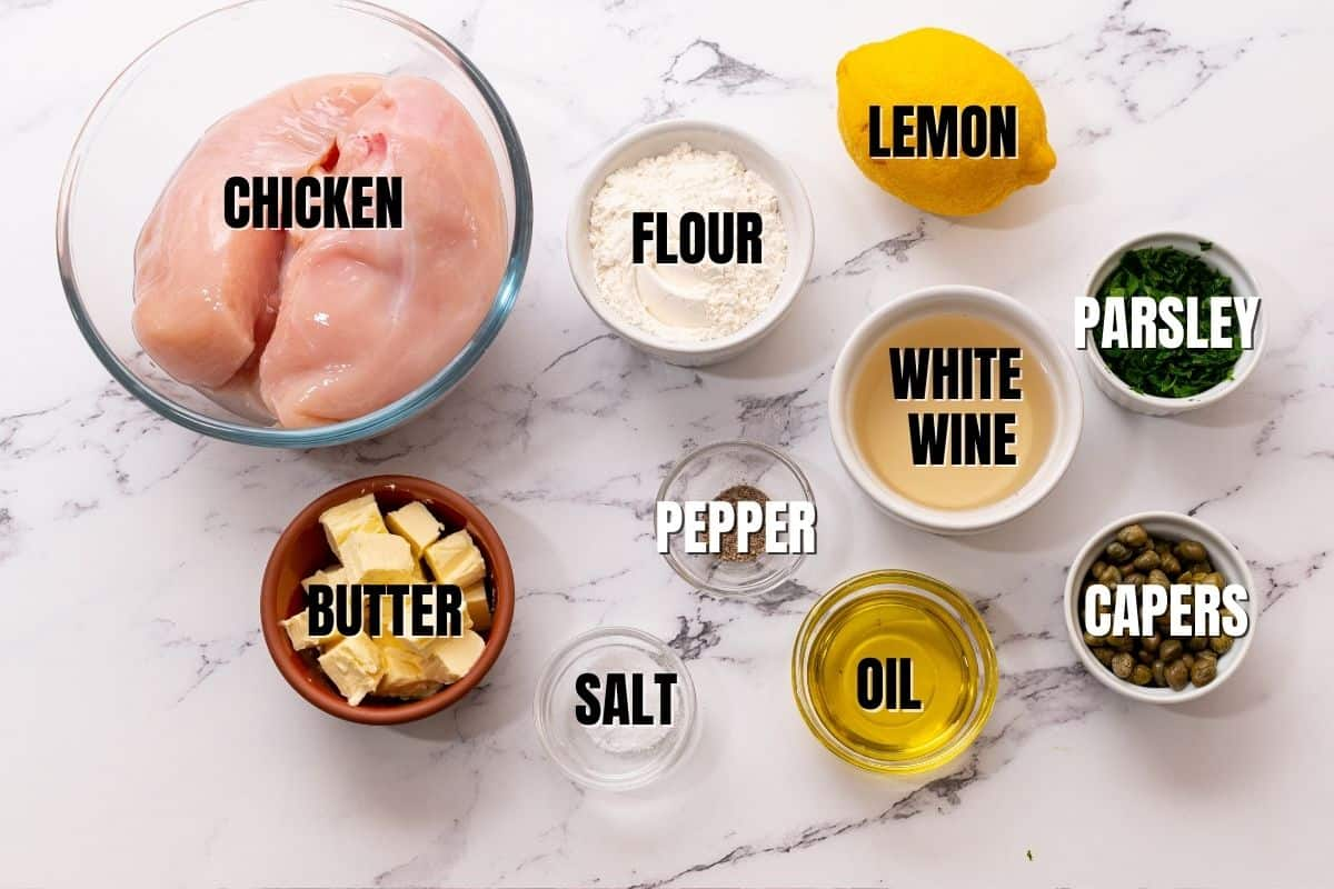 Ingredients for Chicken Piccata labeled on white counter.