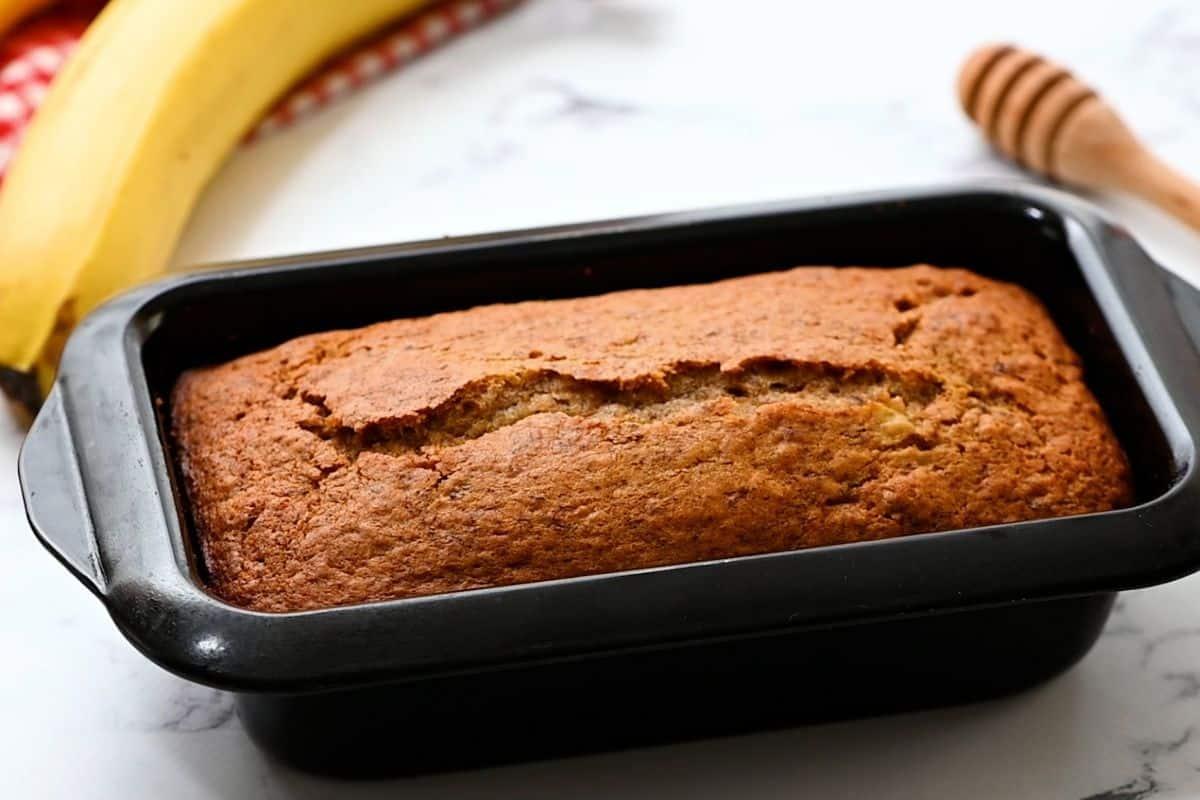 Baked Banana Bread in black loaf pan.