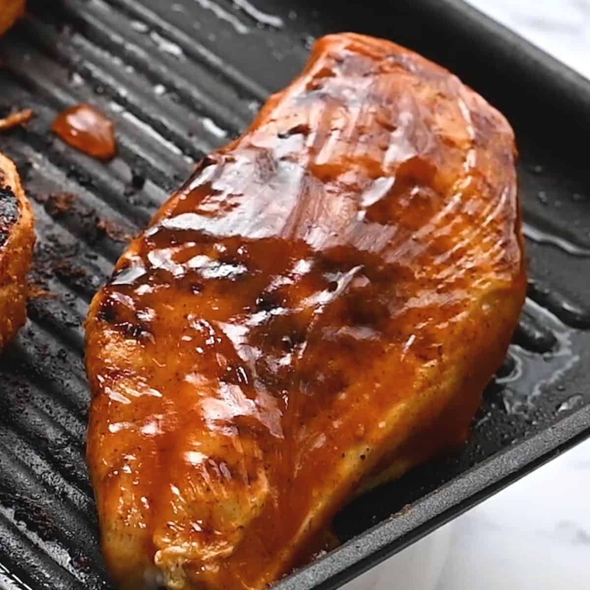 BBQ sauce over chicken breasts.