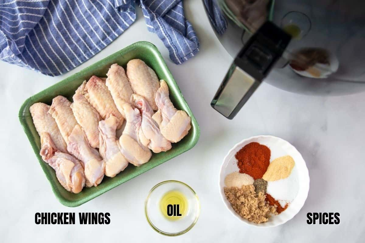 Ingredients for chicken wings labeled on counter.