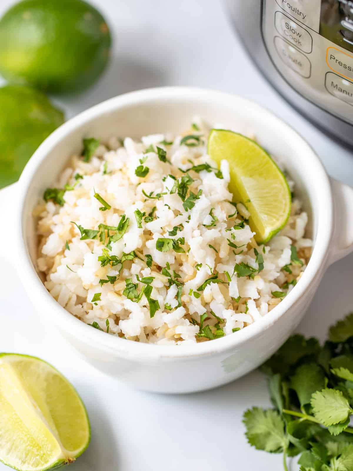 Bowl of cilantrol lime rice next to instant pot.