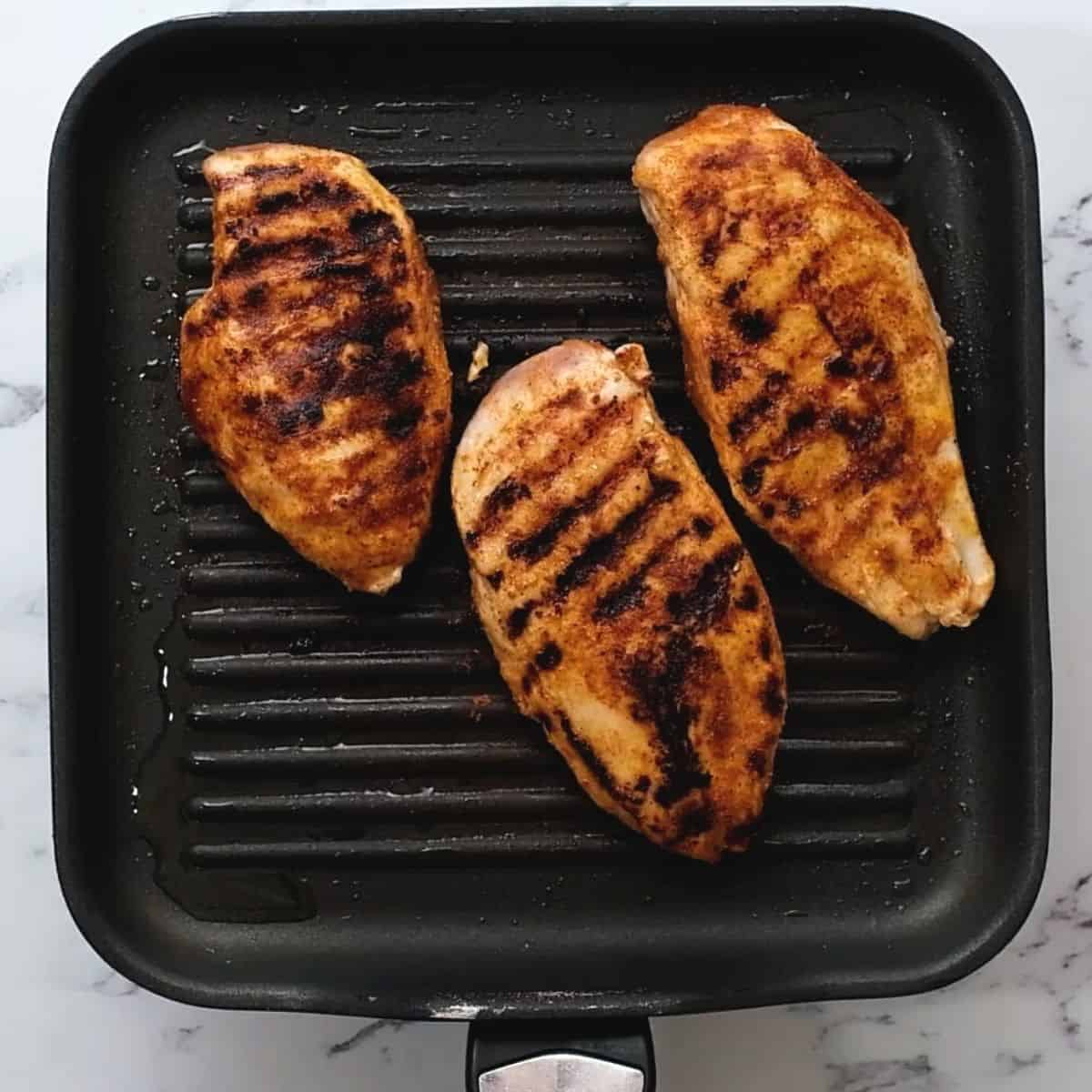 Grilled CHicken on grill plate.