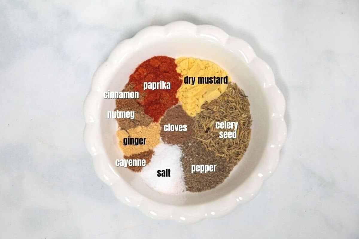 Seasonings for Old Bay labeled in white dish.