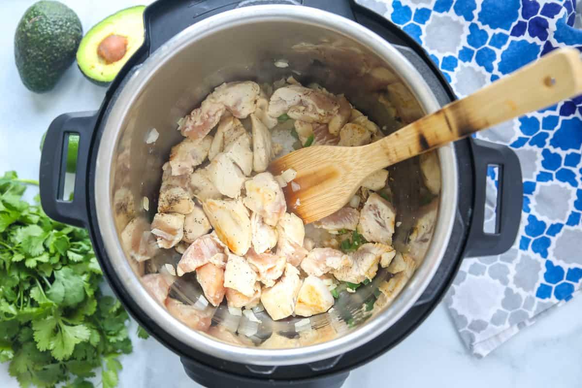 Browned chicken in inner pot of instant pot.