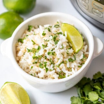 Bowl of cilantrol lime rice next to fresh limes and the Instant Pot.