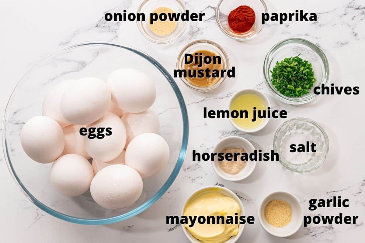 Ingredients for deviled eggs on counter.