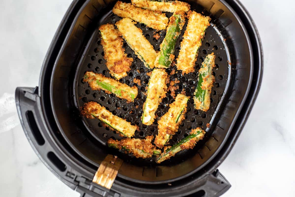 Basket with air fried zucchini fries.
