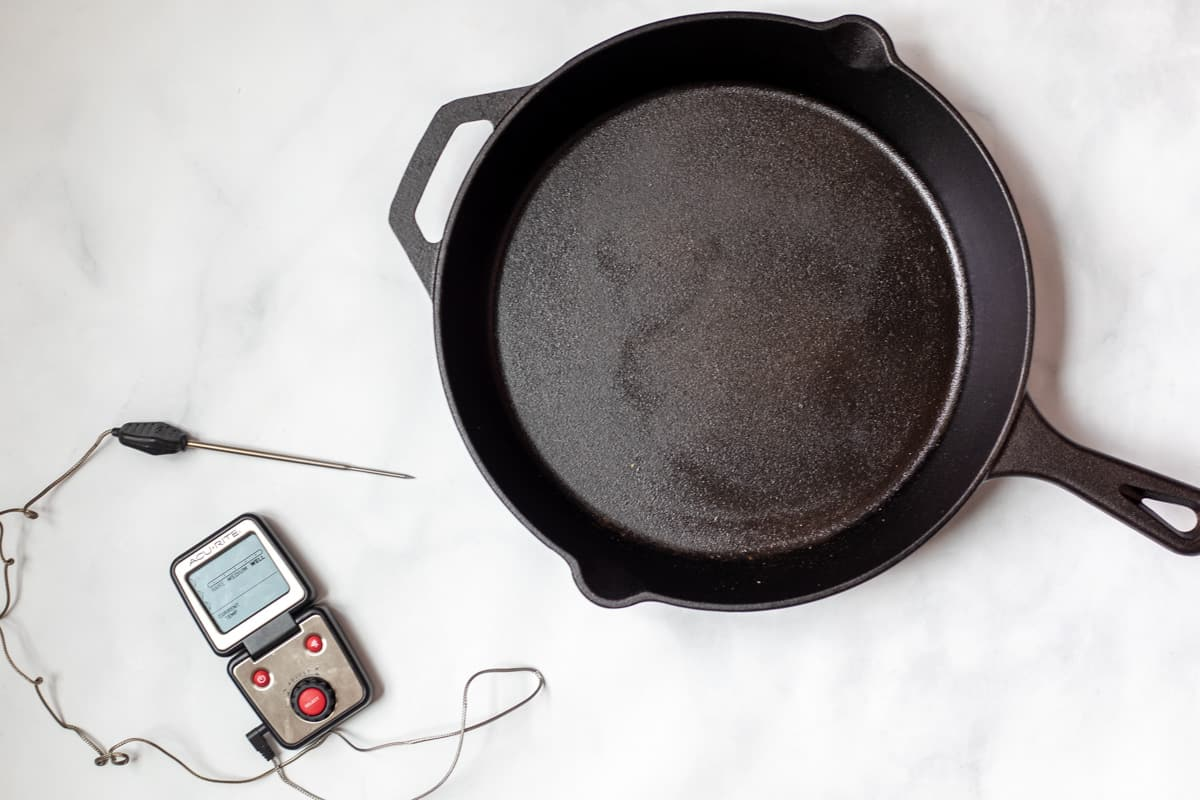 Casti Iron Skillet and digital thermometer on counter.