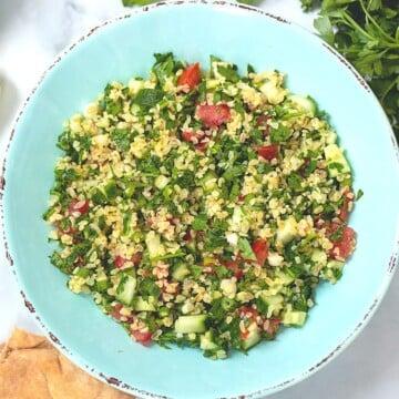 Tabbouleh in blue serving bowl.