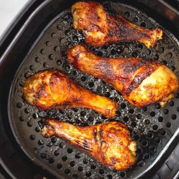 Air Fried Chicken Legs in basket of air fryer.