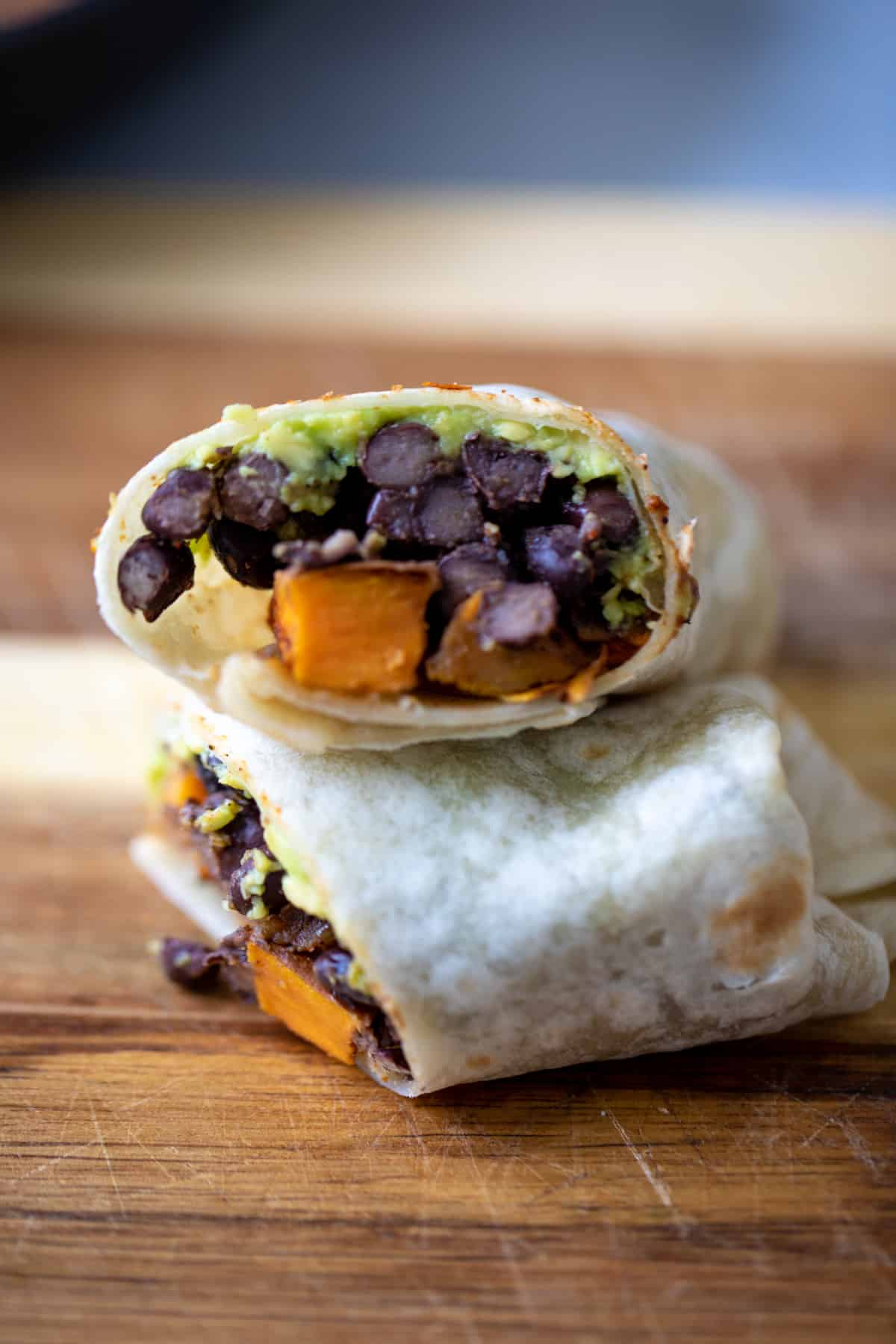 Burrito filled with black beans, sweet potaoes and avocado.