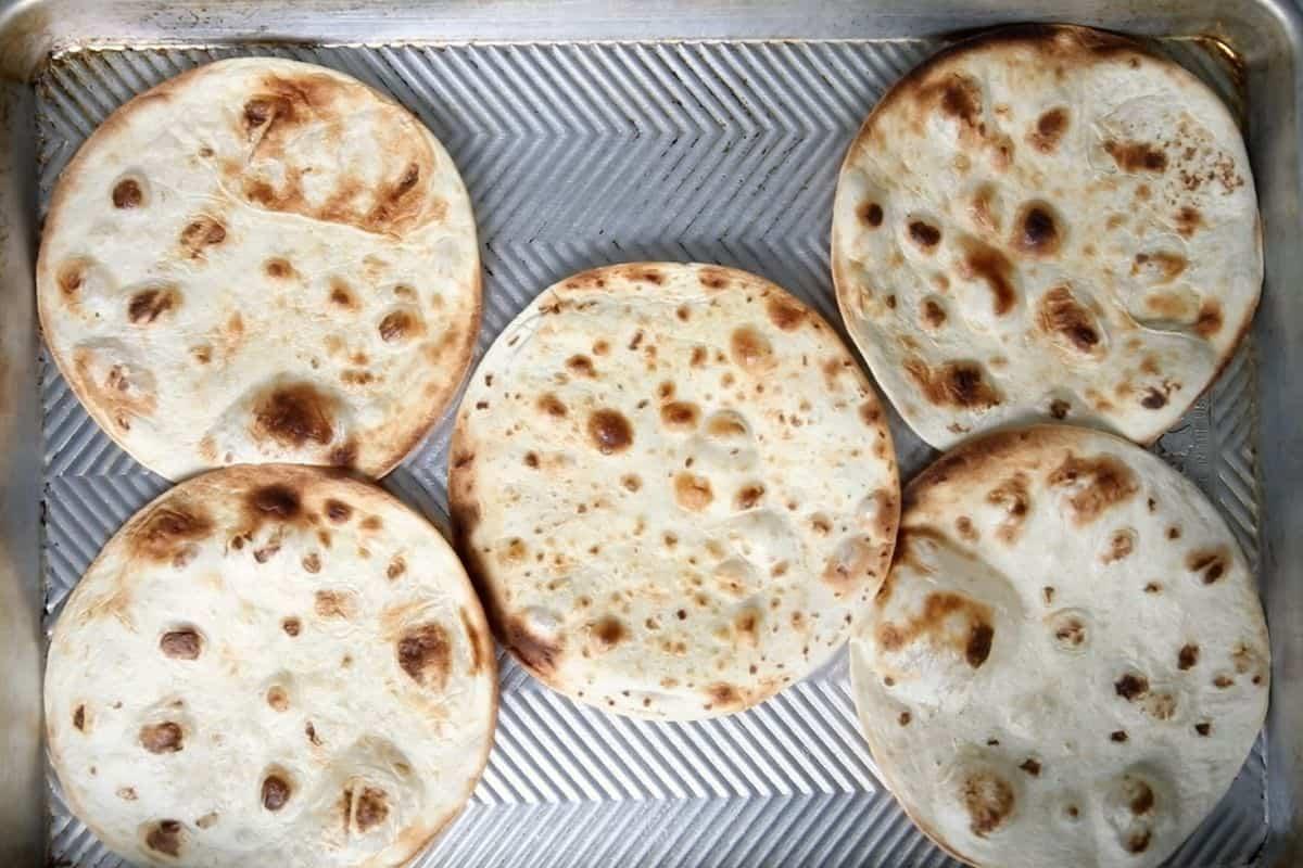 Toasted Tortillas on sheet pan.