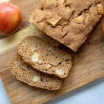 Sliced apple bread on wooden cutting board.