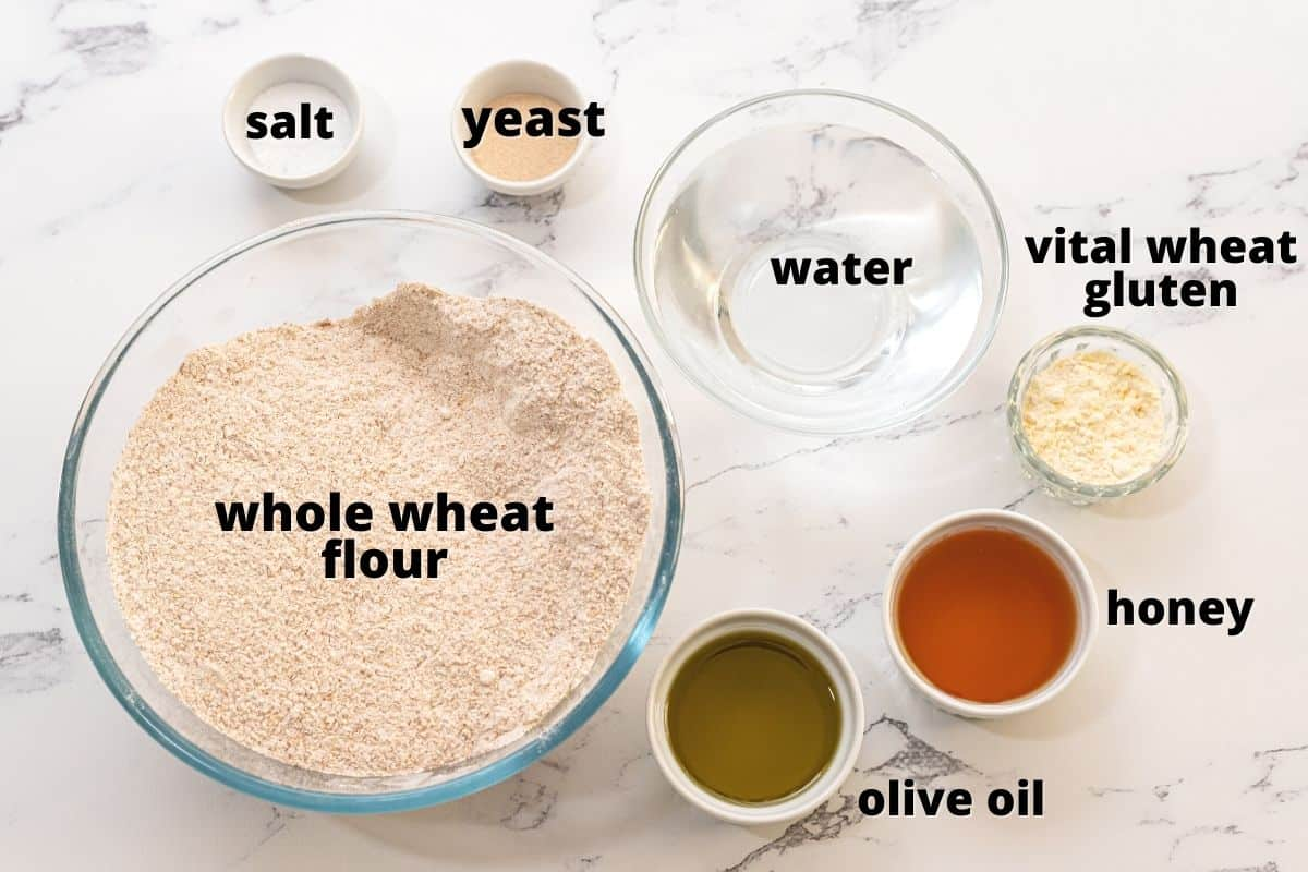 Ingredients for Whole Wheat bread labeled on counter.