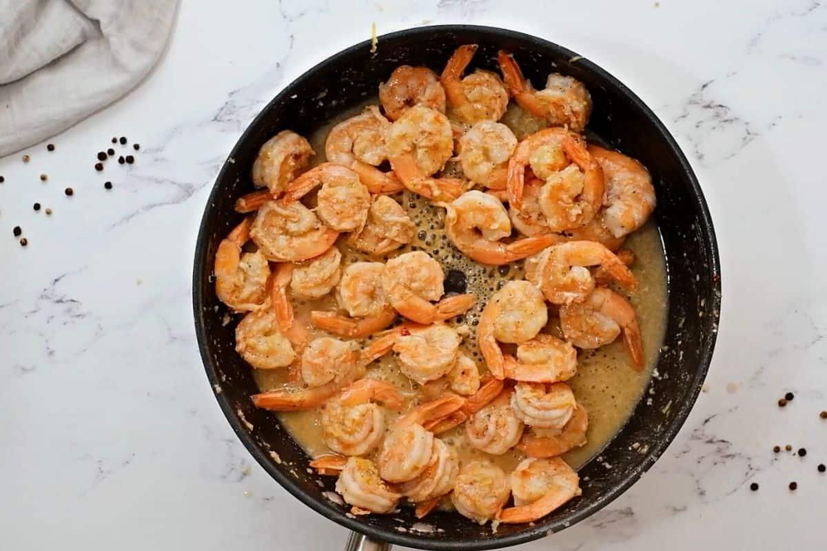 Shrimp scampi in skillet.
