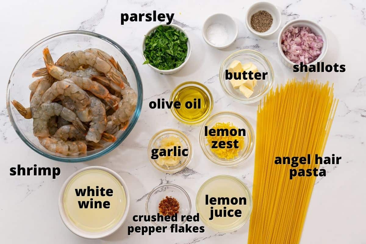 Ingredients for Shrimp Scampi on counter labeled with black text.