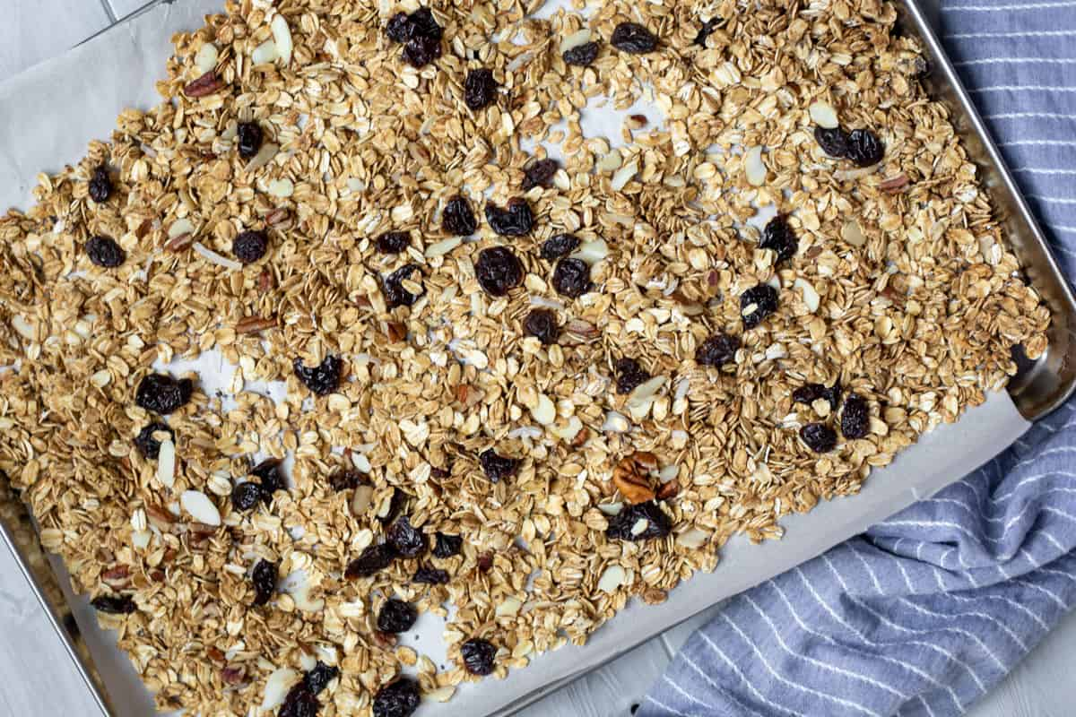 Granola on sheet pan with dried fruit.