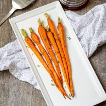 Roasted Carrots on white serving dish.